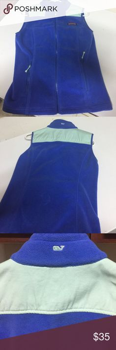 Vineyard vines fleece vest Used good condition.  Has black mark on tag.  Zippered pockets Vineyard Vines Tops