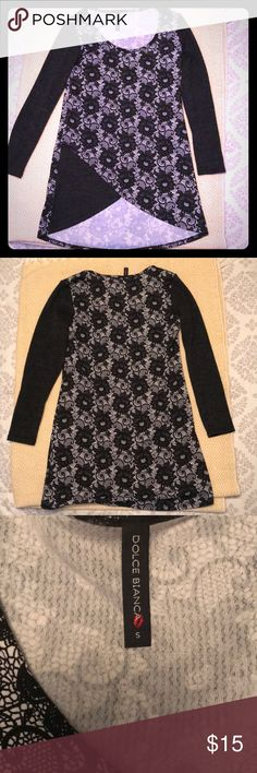 Brand new! Flattering black & grey tunic. Very flattering! Black & white patterned tunic. Unique criss cross detail at the bottom. No tags but never even tried it on. Excellent quality. Dolce Bianca Tops Tunics