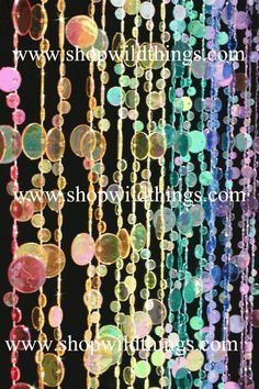 beaded curtains...they even have glow in the dark ones.  How fun for the girls' closet