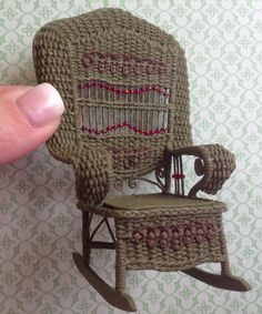 Haywood-Wakefield wicker rocker with bead back detail. By miniature artist Jan Surette of Jantiques Miniature Arts. 1/12th scale.