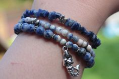 You get exactly whats in the picture, all my jewelry is one of a kind. - THREE BRACELET STACK - you are purchasing THREE bracelets that come together! - 6mm round, 8mm round, and small chip genuine sodalite beads. - Silver tone mermaid charm and accents. - 6.5 Inches un-stretched (approximately). These bracelets best fit people with a small/medium frame. - Ships from Canada.  Bracelet stacks are all the rage - but why go through all the trouble of looking for pieces that go together when…