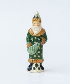 This Irish Santa was created as the second Santa decorated to show the spirit of the Irish! It's green coat decorated with shamrocks is delicately painted t
