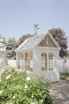 made from old windows - cute for a greenhouse, a playhouse or a tea house