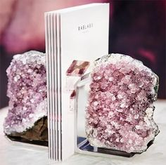 The hottest registry gifts this season incorporate geodes, crystals, and natural minerals. These geode decor picks will pop long after the honeymoon! Crystal Room, Crystal Decor, Geode Bookends, Geode Decor, Bliss Home And Design, Crystal Aesthetic, Resin Crafts, Decoration, Stones And Crystals