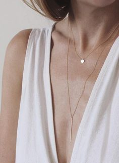 The Vertical Bar Necklace can be layered with pretty much anything - including the delicate Tiny Charm Necklace | Vrai & Oro