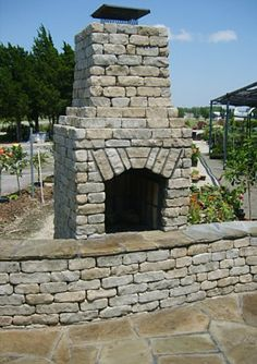 Outdoor Fireplaces & Fire Pits: Aux Vases Tumbled with Shawnee Flag & Coping  www.earthworksstone.net