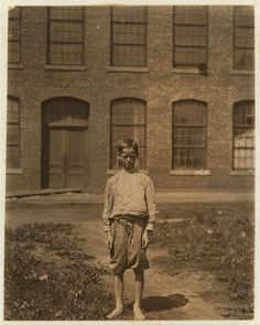 Arthur Newell,12, works in mill, he would rather go to school but the mill wanted him. 1912 Doffer in Manchester Mills by Lewis Hine