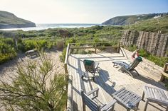Nestled in the sand dunes on the north coast of Cornwall, with direct access to a top surfing beach, you will find Sandcrest Cottage an ideal getaway! Porch And Balcony, Home Porch, Love Home, Ideal Home, House Swap, Home Exchange, North Cornwall, The Dunes