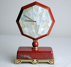 Art Deco style, but made in the 1980s / Cartier Desk Clock / A red hardstone, gilt-metal, and mother-of-pearl desk clock