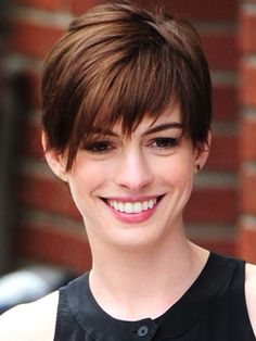 Anne's hair got mixed reviews when she cut it for Les Mis, but we love the long pixie style! It makes her look more grown-up, and the shaggy bangs draw attention to her eyes.   - Seventeen.com