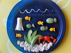 """Under the Sea"" kids snack with avocados, oatmeal, strawberries, and cheese."
