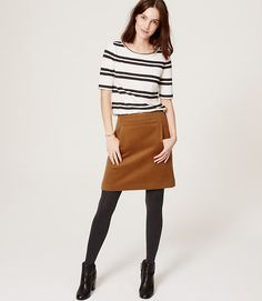 I have this skirt - this color. Wool blend. Hits me just above knees.