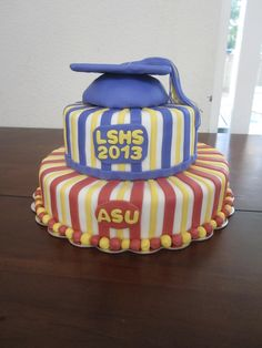 Graduation cake, Top tier represents their high school graduation, the bottom tier represents the college they are heading to in the Fall.