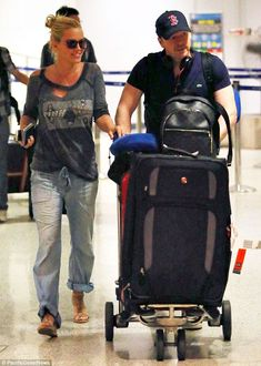 It must have been refreshing! Jenny McCarthy and her fiance Donnie Wahlberg arrived back at JFK in New York City on Wednesday after jetting ...