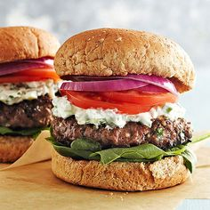 Greek Feta Burgers . . . These tasty, healthy Greek beef burgers are just 342 calories each. The calories are low but the flavor is high, thanks to feta cheese mixed in with the meat and a tzatziki-inspired cucumber sauce.