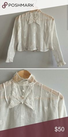 """1910 vintage Edwardian cotton blouse Embroidered bow pattern throughout, netted neck, buttons at the back excellent condition for its age. Just a pinhole on the neck. Bust : 34"""" length: apx. 17"""". NOT ANTHROPOLOGIE Anthropologie Tops Blouses"""