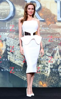 Angelina Jolie strikes a pose in a structured white Ralph & Russo dress at the World War Z premiere in Berlin.