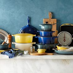 Le Creuset is a classic French cookware brand. The first Le Creuset foundry opened in 1925 and specialized in cast-iron cookware. Today, every piece of Le Creuset cast iron still passes through the hands of 15 skilled craftsmen in France. Le Creuset Cast Iron, Le Creuset Cookware, Enamel Cookware, Cast Iron Cookware, Cookware Set, Kitchen Utensils, Kitchen Knives, Kitchen Gadgets, Kitchen Tools