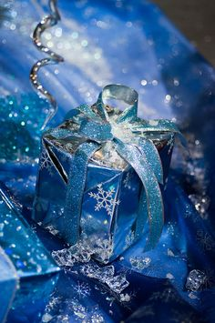 "Blue and silver Christmas wrap. Photo: ""blue gift"" by raspberrytart on Flickr."