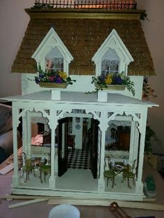 The front of the dollhouse is coming along. Still need to figure out the signage and name of the tea room.