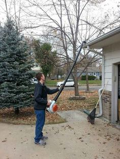 Attach PVC pipe to your lawn blower so you can clean out your gutter with your feet firmly planted on the ground