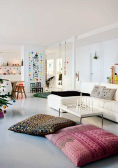 White Living Room. Love the giant floor cushions