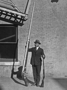 "Chief United States Game Warden George A. Lawyer, with a 10'9"" punt gun weighing 250 pounds. Used for duck hunting."