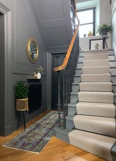 Grey walls with black doors are brought to life with brass accents and a pink rug. Original Victorian balustrade has been returned to its original splendour in black cast iron. a diagonal herringbone oak floor adds further character. Home Interior Design, Interior And Exterior, Interior Architecture, Hallway Ideas Entrance Narrow, Modern Hallway, Entrance Hall, House Staircase, Black Staircase, Staircase Design