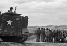 Government officials in an Armored Personnel Carrier(APC) stand watch over Wounded Knee activists, 1973.  Photo credit: Jim Hubbard