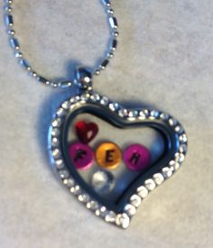Hand-stamped floating confetti and jewels   found at www.charmingincentives.com   #floating #charm #locket