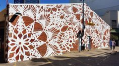 The idea of beautifying an outdoor space seems straightforward enough – flowers and sculptures and whatnot – but Polish street artist NeSpoon turns that idea into something so beautiful…