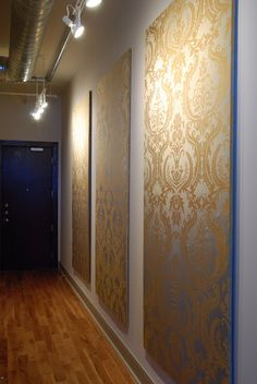 4'x8' foam insulation boards from Home Depot covered in damask fabric = gorgeous DIY upholstered wall hangings. Clever!