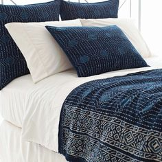 Pine Cone Hill | Resist Dot Indigo Coverlet | Inspired by traditional Indian kantha quilts, this cotton coverlet features a block-style print on an ink-colored background.