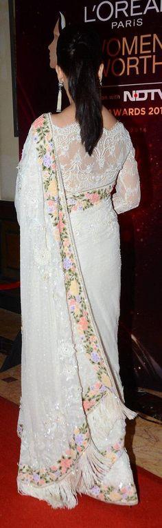 Aishwarya rai in a beautiful sare. love the gorgeous pony tail