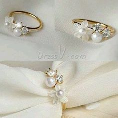 Gorgeous flower w/ pearls and diamonds ring