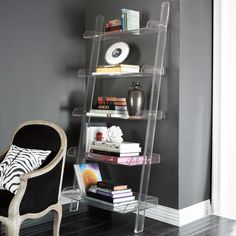 love the wall color and the acrylic bookshelf (from wisteria) Leaning Bookshelf, Leaning Shelf, Bookshelves, Ladder Shelves, Bookshelf Plans, Bookshelf Styling, Lucite Furniture, Acrylic Furniture, Home Decor Furniture