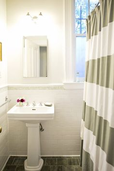 Meg's Classic Glamor Apartment House Tour | Apartment Therapy -- Tile waiscot with trim detail for kids' bath