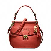 Coach's New Poppy Handbag in Brass (almost Tennessee orange)