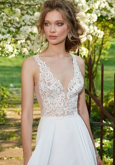 Ivory chiffon Aline gown, Venise lace bodice with V neckline, illusion lace back and chapel train.