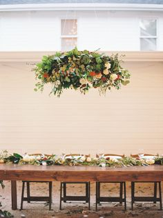 Hang a floral installation above your head table for an added pop! #cedarwoodweddings 10.15.17 :: Rin + Colin | Cedarwood Weddings