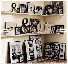 family room - black and white photos framed