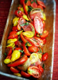2 pounds cherry or pear tomatoes  3 Tablespoons balsamic vinegar  1/2 cup extra virgin olive oil  1 teaspoon sugar  1/2 teaspoon kosher salt  1/2 teaspoon fresh cracked pepper  1/2 cup shredded fresh basil