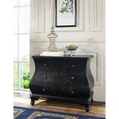 Create a stylish vignette or stow spare dinnerware in your dining room with this lovely bombe chest,