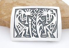 This is a Hopi Native American sterling silver belt buckle with two Kokopellis playing the flute to bring about spring rains.