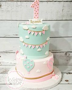 First birthdays are so fun!I love this adorable hot air balloon theme in pinks, mint and gold! #firstbirthdaycake #hotairballoon #hotairballoon #arizonacakes #gilbertcakes
