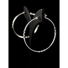 Серьги из серебра 925 пробы. Дизайн: кольца. Размеры: ширина 2 x 40 мм, высота 40 мм.