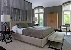 bedroom, guest bedroom, master bedroom, guest suite, bed, curtain, divider, drapery, nightstand, armoire, chair, windows, shelves, gray, neutrals