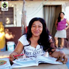 Rosa is all smiles while completing her homework for her adult elementary school course thanks to a scholarship supported by #FairTrade Funds. Like to show your support for Rosa, a strong (and smart!) #woman of Fair Trade! #inspirational #education #empowerment