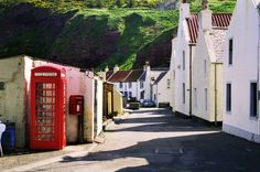 Pennan, Scotland I'VE BEEN THERE!! Mom and I stumbled down a single track road that went straight down the side of a mountain, and ended up in the smallest, mose adorable town: a strip of shore nestled between two cliffs. The phone box was there, and everything. ♡♡