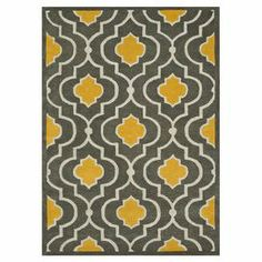 Wool rug with a quatrefoil motif. Handmade in India.    Product: RugConstruction Material: 100% WoolColor: Grey and goldFeatures:  HandmadeMade in India Note: Please be aware that actual colors may vary from those shown on your screen. Accent rugs may also not show the entire pattern that the corresponding area rugs have.Cleaning and Care: Clean spills immediately by blotting with a clean sponge or cloth. Vacuum carefully without beater bar. Expect shedding. Professional cleaning ...